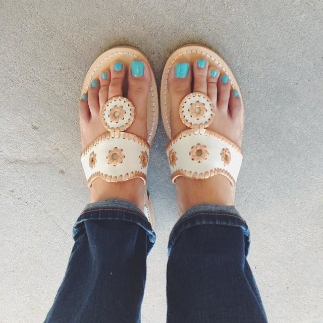 Jack Rogers sandals in a neutral color.