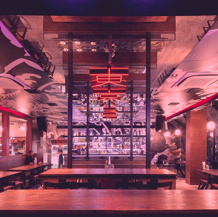 this eating hub projects the typical japanese anime movie culture into a physical neo-tokyo design.