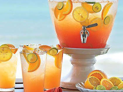 Perfect for the beach, take along a batch of Seaside Sunrise. Blend bright juices and passion fruit rum, and then top with bubbly for a tropical twist on a mimosa.