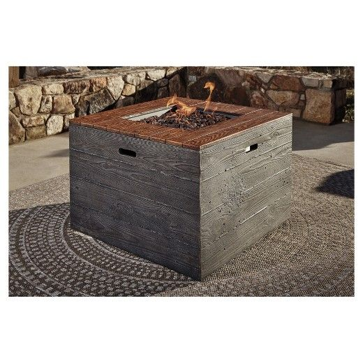 The Hatchlands fire pit table mirrors the rustic ambience of the great outdoors. Oversized square design has the look of richly grained wood, with none of the splintering qualities. Included burner cover transforms the fire table into an expansive coffee table.  Signature Design by Ashley is a registered trademark of Ashley Furniture Industries, Inc.