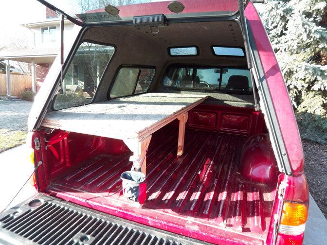 Truck bed sleeping setup with spilt platform.  Nicely done.                                                                                                                                                      More