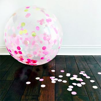Like sunshine and lollipops, these giant confetti-filled balloons add frivolity and fun to any celebration.