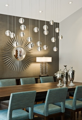 "Create unique dining light. ""Instead of using chandeliers over a rectangular dining room table, try using multiple pendants to create the feel of a large chandelier,"" Thompson advises. Also, remember that dimmers are a must-have in the dining room."
