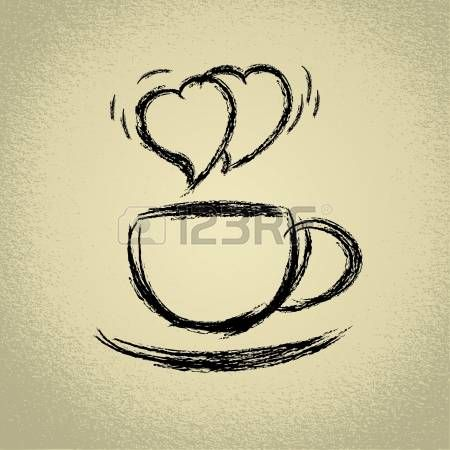 Tazza di caff� caldo a forma di cuore fumante photo
