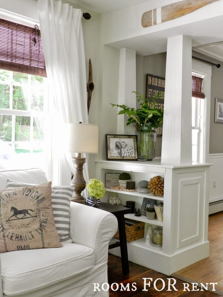White columns with built in shelves . . . great to divide up a room and give the feel of an entry area. ♥