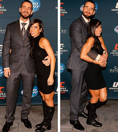 Former WWE Superstar CM Punk  (Phil Brooks) and his wife WWE Diva AJ Lee  (April Mendez) at a UFC event