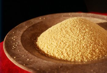 Here is a basic, foolproof recipe for cooking couscous and a description of what it is—grain or pasta—where it comes from, and how to serve it.