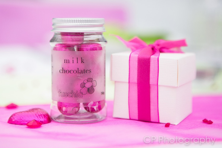 Pretty in pink, these stunning wedding and party favours are just perfect to add a special touch to your table.  Your guests will enjoy this sweet touch!  Double ribboned favour boxes complete with 2 heart chocolates or mint imperial fillings for £1.99 each.  Milk chocolate balls in pink foil wrappers are gorgeous in our Fuschia candy jars at £2.99 each.  Order at the Fuschia Boutique at www.fuschiadesigns.co.uk.