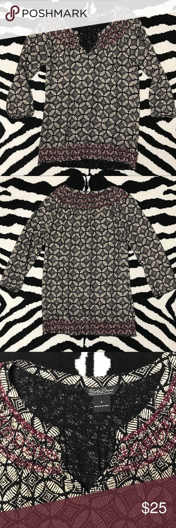 """Lucky Brand Printed Blouse Lucky Brand Printed Blouse. Three quarter length sleeves, V-neck style blouse with smocking detail on neckline and waistband. Colors: Black/Burgundy and Tanish/Cream. Chest measures: 17.5"""" flat length 26"""" Lucky Brand Tops Blouses"""