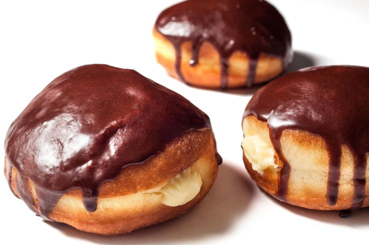 Try this delicious recipe for Boston cream donuts: basic yeast donuts filled with vanilla custard and glazed with chocolate glaze.