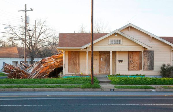 A Condemned House Explodes Onto the Streets of Austin wood installation Austin architecture