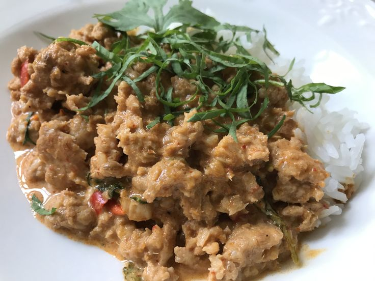 This spicy Thai ground chicken red coconut curry with holy basil will HURT SO GOOOOOOOOOD! Learn more at:  https://www.platecations.com/single-post/SpicyThaiChickenRedCoconutCurry