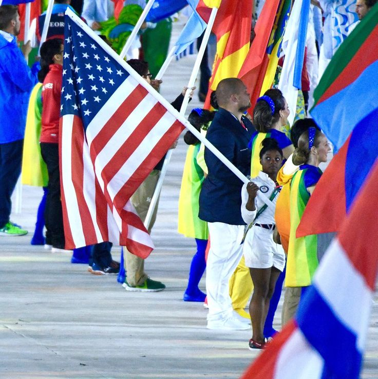 Simone Biles is the flag bearer for USA in the Rio Closing Ceremony.