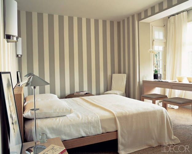 Wall treatments say it with stripes striped walls elle for Bedroom stripe paint ideas