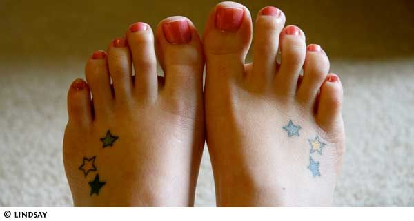 cute foot tattoo. but on just one foot with the stars filled in with my boys birthstone colors.
