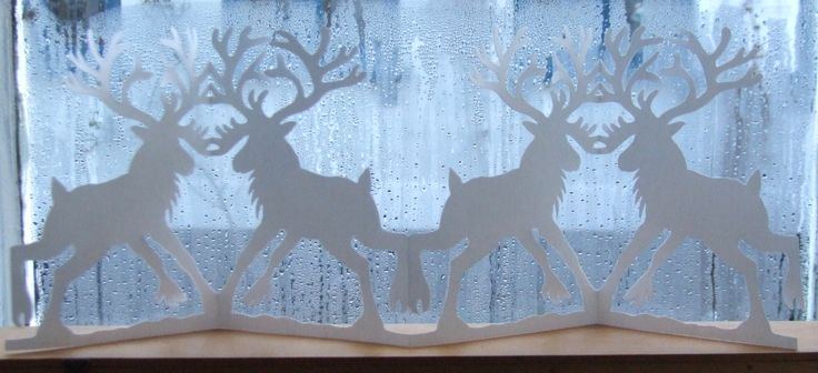 Papercut for christmas decoration, reindeer dancing. By Naja Abelsen. Sold, similar can be ordered.