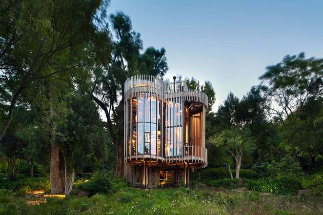 Wood & metal treehouse is a modern gem nestled among the trees