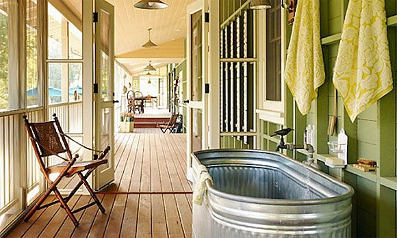 12 serene screened porches - Outdoor bathtime A galvanized steel tub is a surprising but charming fixture in this bright and breezy screened patio. It's perfect for washing up mud-soaked pets or kids before they run into the house -- or even, with the addition of a privacy screen, for an impromptu dip in the fresh air.