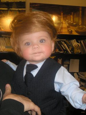 baby wearing a Donald Trump toupee!