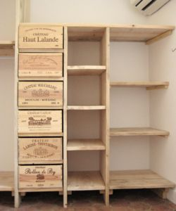Wine crates as drawers for closet storage (site in French, does not translate well)
