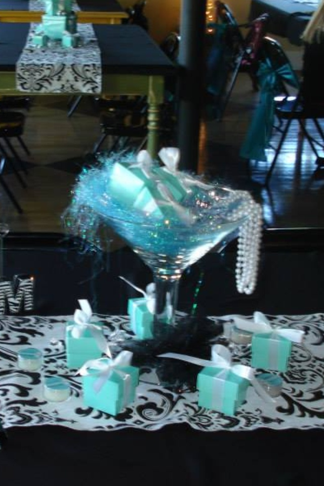 Tiffany themed centerpiece..big martini glass filled with pearls and diamonds and Tiffany boxes