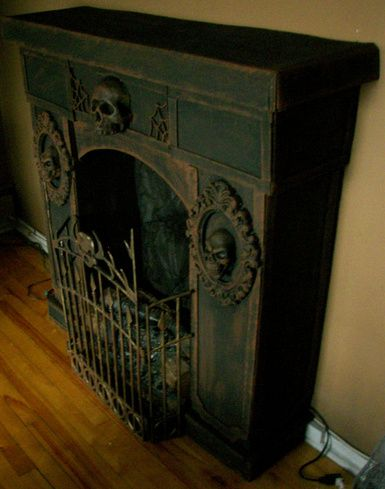 Faux fireplace ~ Crafted from cardboard and Dollar Store items - from halloweenforum