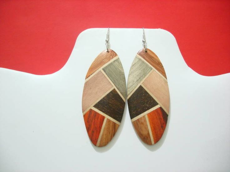 "Long Oval Wooden Geometric pattern earrings.  2.5"" length.  Would make nice 70's earrings."
