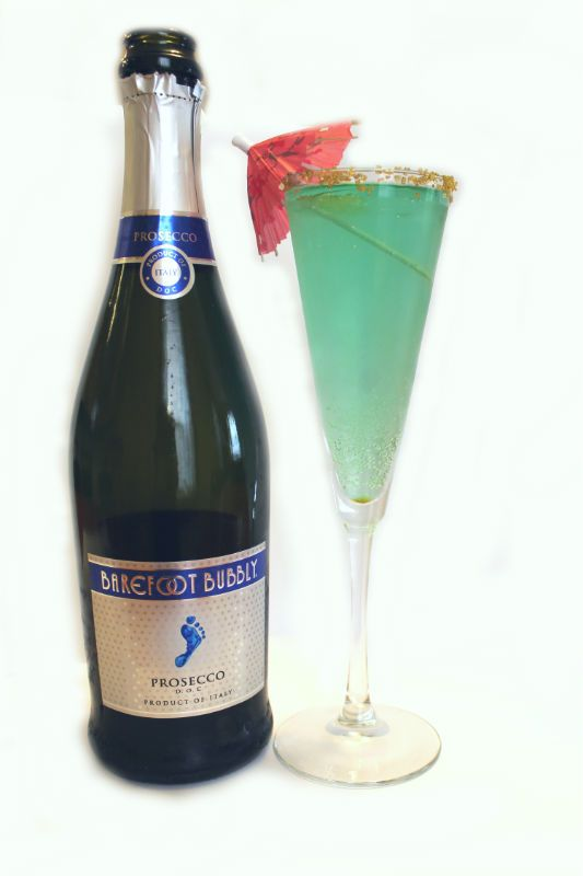 Little Mermaid-themed cocktail made with Barefoot Bubbly's Prosecco, Blue Curacao, and gold sprinkles!