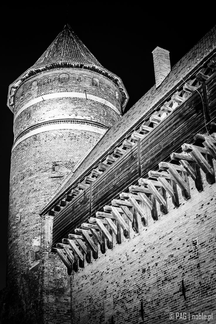 The tower and walls of the 14th century Gothic Castle of Warmian Bishops in Olsztyn, the capital of Warmia & Mazury Lake District, northern Poland