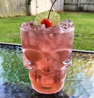 DEMON SKULL 1 oz. (30ml) Tequila 1/2 oz. (15ml) Triple Sec 1/2 oz. (15ml) Peach Schnapps 1/2 oz. (15ml) Lemoncello 2 oz. (60ml) Cranberry Juice 2 oz. (60ml) Strawberry Lemonade 1/2 oz. (15ml) Lime Juice