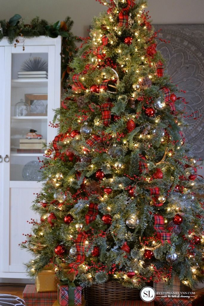 White Christmas Tree With Black Decorations