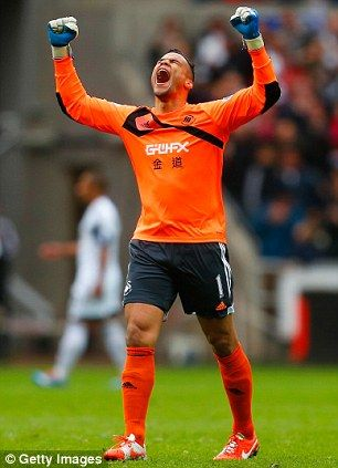 Swansea goalkeeper Michel Vorm enjoys his side's third goal. Swans win 4 - 1