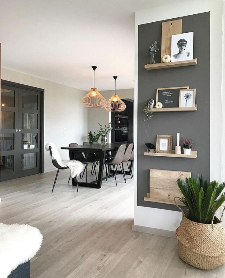 Small Dark wall color mixed w/ light wood shelving…