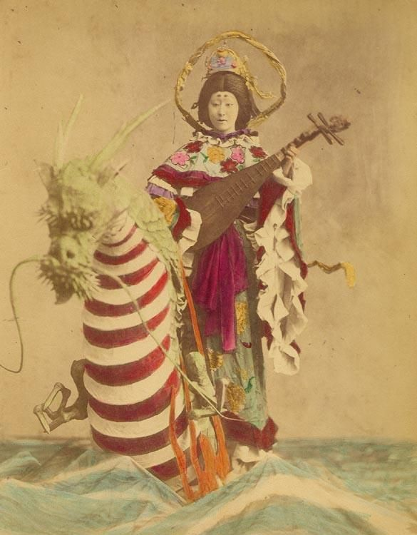 "Benzaiten (弁才天, 弁財天) is a Japanese Buddhist goddess, who originated from the Hindu goddess Saraswati. Worship of Benzaiten arrived in Japan during the 6th through 8th centuries, mainly via the Chinese translations of the Sutra of Golden Light, which has a section devoted to her. Referred to as Sarasvatî Devî in Sanskrit (meaning ""Goddess Saraswati""), Benzaiten is the goddess of everything that flows: water, words, speech, eloquence, music and by extension, knowledge."