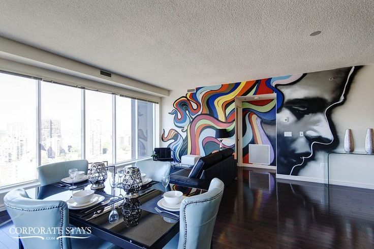 "With urban art from local graffiti artist, ""Omen"" is the most unique furnished rental in Montreal #UrbanArt #Mural #Graffiti #FurnishedApartment"