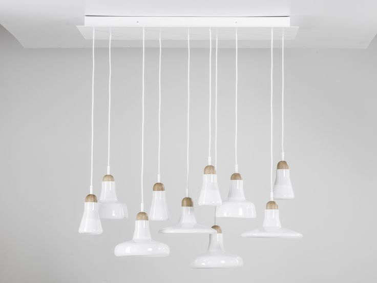 White interior - Brokis lights - White Shadows are hanging lights. The designer Lucie Koldová and Dan Yeffet