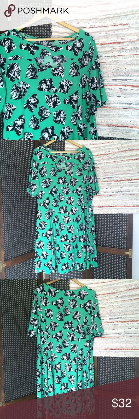 """Spring Time Floral Peep hole Dress Beautiful dress in a pretty green color with black and white flowers. Size 16. Great cut. Peephole in the front. Short sleeve. Slight a line/ princess cut. Moves really feminine. Bust measures 24.5"""" length 40"""".  •I don't swap/trade •I don't do holds  •I rarely model due to the fact that I don't fit all items.  •I price with shipping in mind  •I am open to reasonable negotiations  •Bundle for the best deals  ☮   ❤️   😊 Dresses"""