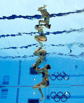 Mirror images - Marie-Pier Boudreau Gagnon and Elise Marcotte of Canada compete during women's duet synchronized swimming final. Canada took fourth in the event while Russia's Natalia Ishchenko and Svetlana Romashina won gold.