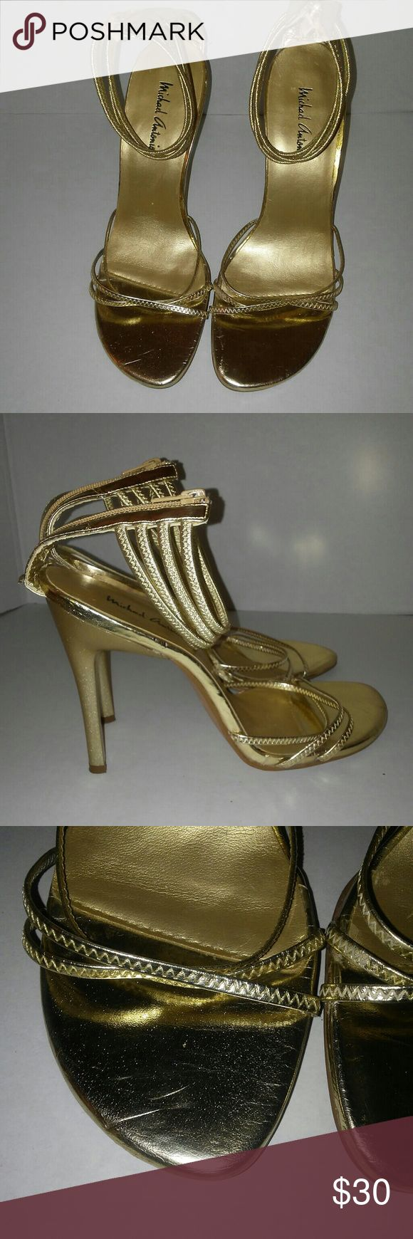 Michael Antonio Women' Gold Strappy Sandals Size 7 preowned good condition zips up in back Straps gigs ankle open toe small scratch near toe area..see photos light wear on bottom Michael Antonio Shoes Heels