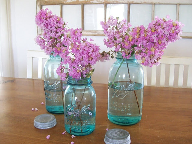Lilacs! Would make the tables smell good and for great center pieces.  I love the teal mason jars.