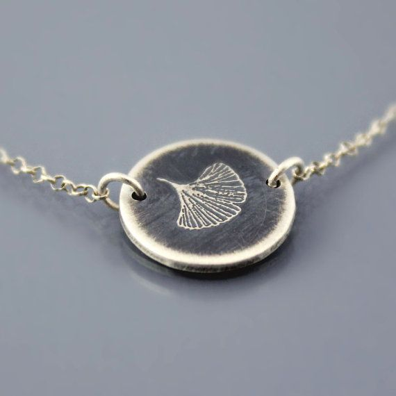 The pin being repinned by W girls everywhere. :)   Ginkgo Leaf Necklace by Lisa Hopkins Design - If anyone needs any gift ideas for me! haha! :)