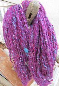 my handspun yarn creations, made from local alpaca and lambswool, threads, beads and swirly fun :)