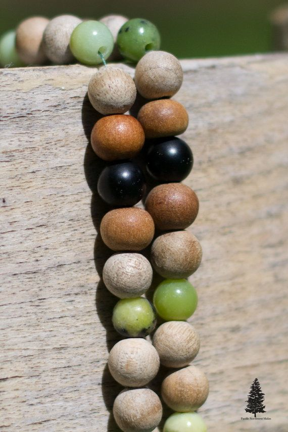 Protection Mala  Designed to help protect you from harsh energies and to help you to let go of negative energies.  Materials used