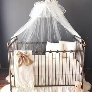 I'll never get over a beautiful canopy drape over an iron crib.  #nursery