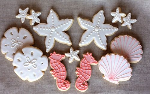 Seashell cookies- pinch the corners of star cookie cutters to make starfish, cut triangles out of circle cut cookes to make sand dollars