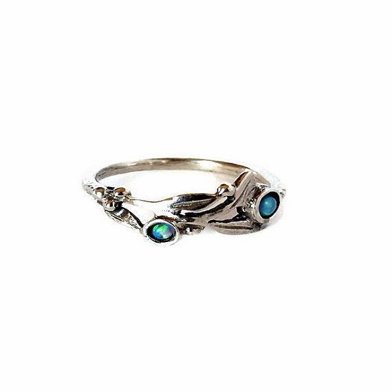 Hey, I found this really awesome Etsy listing at https://www.etsy.com/il-en/listing/484571657/blue-opal-ring-dainty-opal-ring-sterling