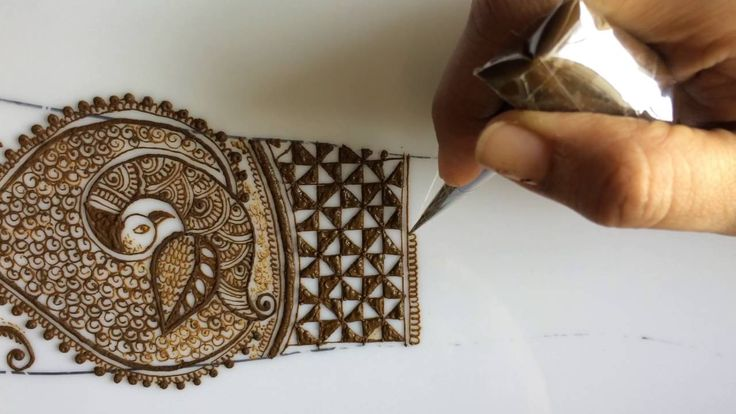 Intricate bridal dulhan mehendi with peacock and dulhan design