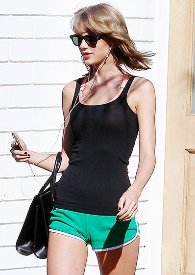 Taylor Swift sported a pair of super-short green workout shorts and a black tank while out and about in L.A. on March 30.
