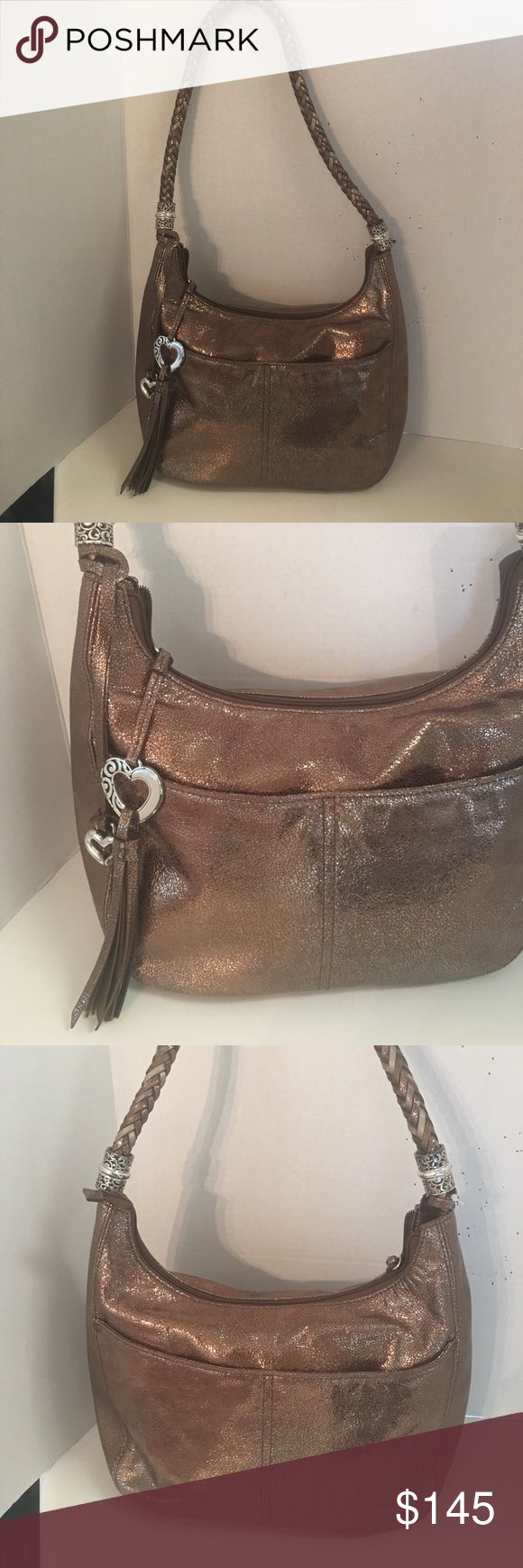 Brighton Metallic bronze leather Barbados hobo This is a beautiful gently used Breitling Barbados collection metallic bronze leather hobo. Features Silvertone hardware with light signs of wear. Four exterior slip pockets. Zipper closure for main compartment. Beautiful multicolored braided leather strap.  Beige lining with zipper pocket into slip pockets inside. Key clip.  Gorgeous bag very gently used!  No dust bag Brighton Bags Hobos