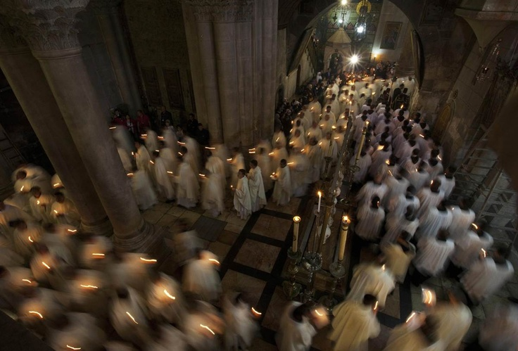 Members of the Catholic clergy hold candles during a procession at the traditional washing of the feet ceremony at the Church of the Holy Sepulchre ahead of Easter celebrations in the Old City of Jerusalem on Thursday April 5. Good Friday is one of the Christians holiest days, commemorating the crucifixion of Jesus Christ and his death at Golgotha.